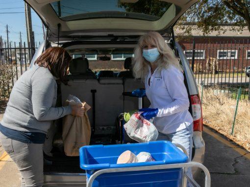 Volunteers loading groceries into car Food Pantry